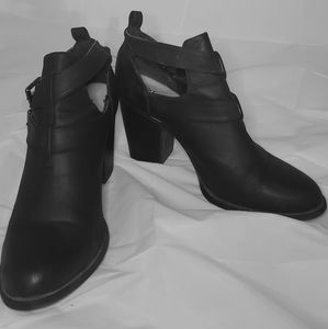 Black booties with buckle detail
